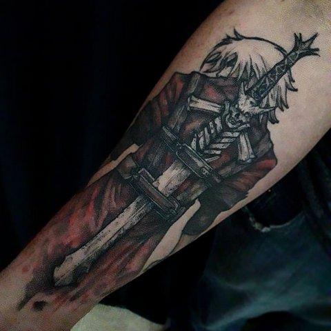 Игровая тату Данте Devil may Cry на руке
