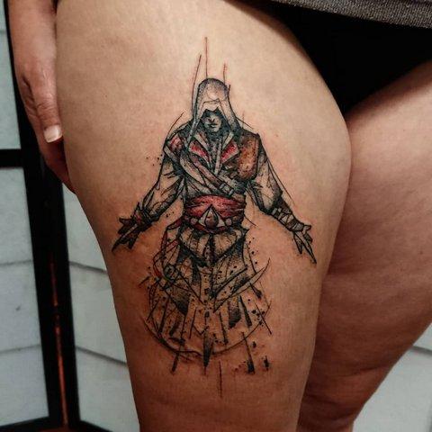 Игровая тату Ассасин на ноге