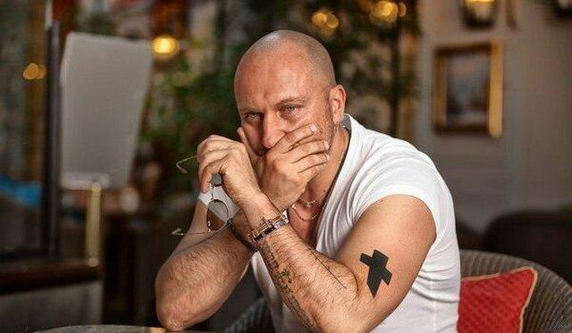 Татуировка крест Дмитрия Нагиева