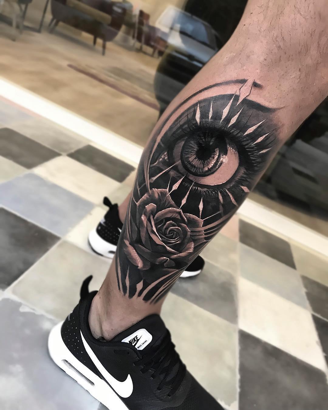 Татуировка Цветок и Глаз на Ноге